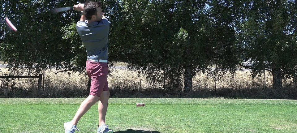 Brady finishes his drive swing at a charity golf tournament